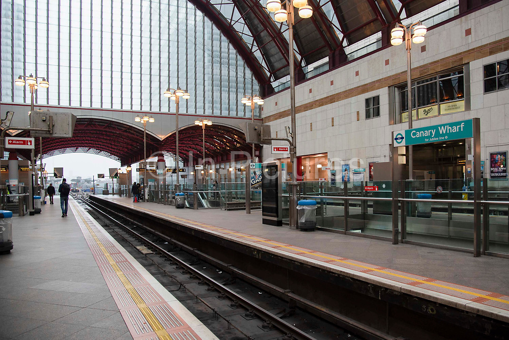 Visibly quiet at Canary Wharf DLR station on 19th March 2020 in London, United Kingdom. More people are working from home and Tranport for London are running a reduced tube and bus service in London in an effort to delay the spread of the  coronavirus.