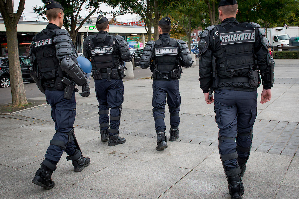 10 years ago, on 27 October 2005, riots broke out in the French suburbs. Patrolling riot police prior to the visit of President Francois Hollande. In this suburb at 5 km from Paris,  four thousand flats have been built here in 1964. 20 October 2015, La Courneuve, France.