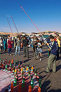 People relaxing in the Jemaa el-Fnaa square in  Marrakech, Morocco