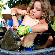 Phierce Williams, 5, from Prague, Okla., attempts to lift up a catfish at the Okie Noodling Tournament in Pauls Valley, Okla., Saturday, June 18, 2016. Photo by Kurt Steiss, The Oklahoman