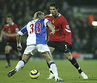Photo: Aidan Ellis.<br /> Blackburn v Manchester United. Barclays Premiership. 01/02/2006.<br /> United's Cristiano Ronaldo takes Blackburn's Michael Gray