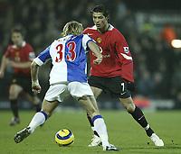 Photo: Aidan Ellis.<br /> Blackburn v Manchester United. Barclays Premiership. 01/02/2006.<br /> United's Cristiano Ronaldo takes Blackburn's Michael Gray