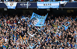 © Licensed to London News Pictures. London, UK. 11/05/2014. London, UK.  Manchester City FC supporters celebrate after  winning the Barclays Premier League  at the Etihad Stadium. 2013/14.Photo credit: LNP