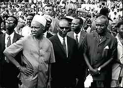 Dec. 12, 1971 - Four visiting Heads of State - from Burundi, Somalia, Zambia and Botswana - were with Tanzanian President Julius K. Nyerere in Dar es Salaam's National Stadium at a mamoth military march-post on the tenth anniversary of Tanzania's independence. The military review climaxed more than a week's celebrations. A crowd estimated at 30,000 people roared their approval as units of the Tanzanian People's Defence Force, the People's Militia, Police, National Service and Young Pioneers marched past the presidential stand. captions for pictures: President Julius Nyerere arrives at the National Stadium. With him are Somali President Mohammes Siad Sarre and Zambian President Kenneth Kaunda. Credit: Camerapix (Credit Image: © Keystone Press Agency/Keystone USA via ZUMAPRESS.com)
