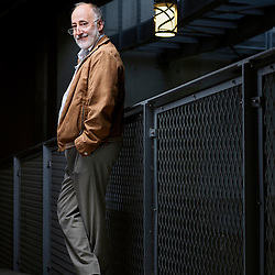 Paris, France. July 12, 2016. Light designer Robert Narboni posing in a covered street of which he created the urban lighting. He designed the suspended lamp on the right side of the photo. Photo: Antoine Doyen