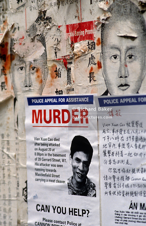 "Pasted to the wall in Gerrard Street, Soho, in London's Chinatown, the Metropolitan Police are appealing for witnesses to help with their investigation of a murder of Vien Xuan Cao, a Chinese immigrant who was murdered in this street after being attacked with a meat cleaver. The implication is that this was a Triad turf war, a territorial dispute between gang members of this secret society. We see the young man's face photocopied to the paperwork, laid over more traditional images of ethnic Chinese and a boxing contest promotional poster. ""Can you Help?"" reads the Police's appeal and alongside, the same text has been translated into Chinese for locals to read."
