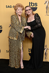 Debbie Reynolds and Carrie Fisher backstage in the Press Room at the 21st Annual Screen Actors Guild Awards, held at the Shrine Auditorium in Los Angeles, California.