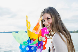 Portrait woman holding toy windmill