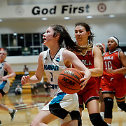Hawai'i Pacific guard Amy Baum (3)  drives hard to the basket past Biola forward Madi Chang (21) during the PacWest basketball championships semifinals in the Felix Event Center at Azusa Pacific University Friday, Mar. 6, 202, in Azusa. (Mandatory Credit: Christina Leung-Sports Shooter Academy)