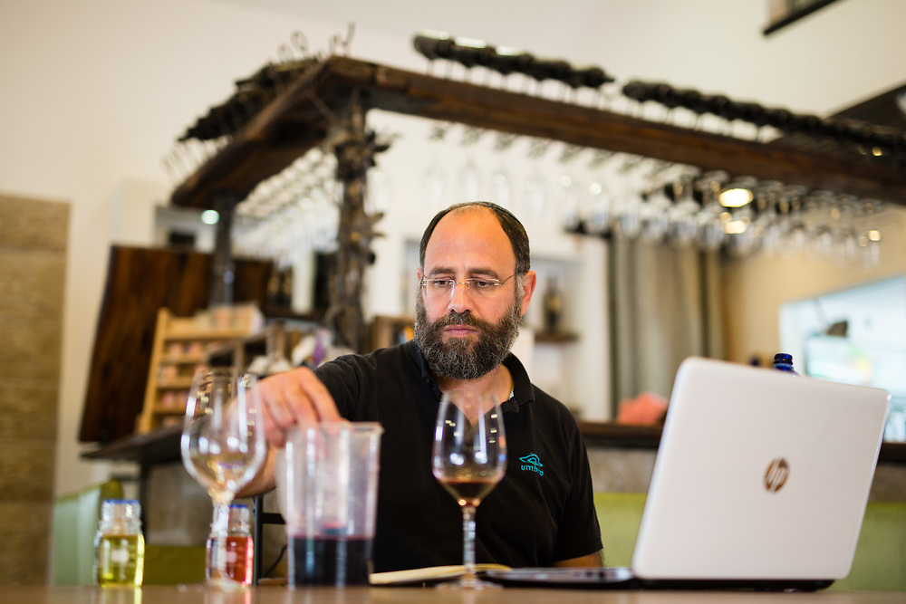 Jewish Israeli winemaker Yaacov Oryah is seen as he checks acidity levels after Malolactic fermentation, at Psagot Winery in the West Bank Jewish settlement of Migron, near the Palestinian West Bank city of Ramallah, on November 17, 2015.