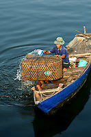 Phu Quoc Island's primary industry is fishing and the preparation of fish sauce, a popular condiment in Southeast Asia.  Fishermen predominate the scene here, such as this one at Duong Dong port.