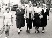 three generations women family strolling France ca 1950s