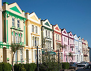 Colourfully painted guesthouses and hotels on the Esplanade, Paignton, Devon, England, UK