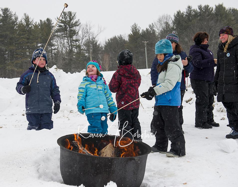 Cooking marshmallows over the fire during Winterfest activities at Prescott Farm.  (Karen Bobotas Photographer)