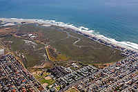 Aerial view of the Tijuana River National Estuarine Reserve and Tijuana River mouth looking southwest.