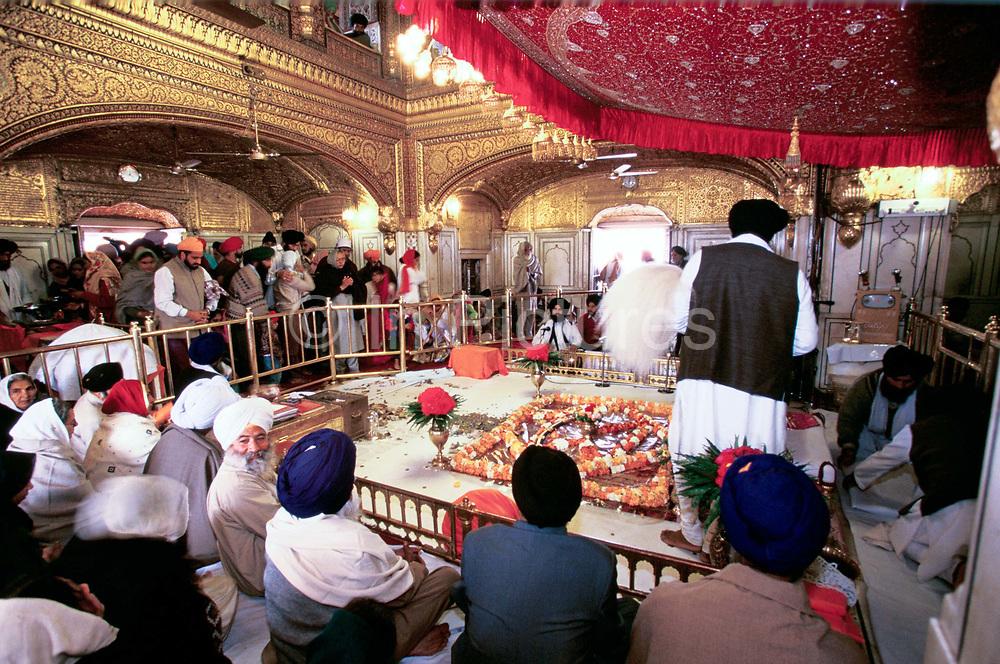 Reading from the Shri Guru Granth Sahib, the Sikh holy text..Golden Temple, Amritsar, India