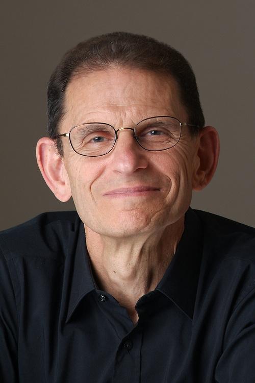 Headshot of consultant David Levin in the studio.