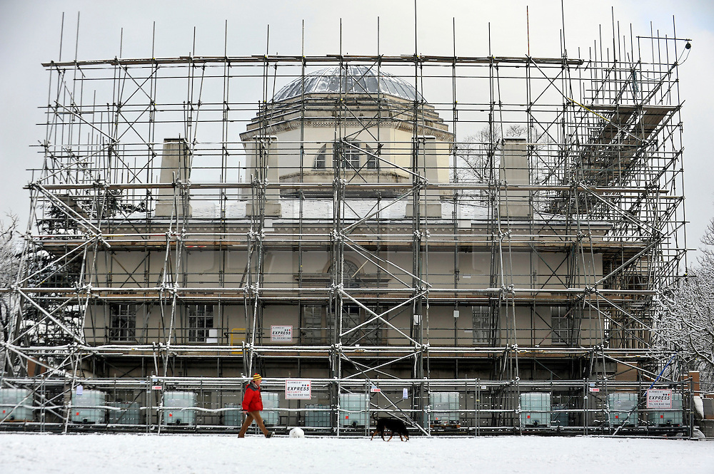 © Licensed to London News Pictures. 10/02/2012, London, UK.  Chiswick House. People enjoy the snow in the grounds of Chiswick House in West London today 10 February 2012. Chiswick House, undergoing restoration,  is the first and one of the finest examples of neo-Palladian design in England.  Inspired by the architecture of ancient Rome and 16th Century Italy, the third Earl of Burlington built the house as a homage to Renaissance architect Palladio.The cold weather across the UK is set to continue over the weekend.  Photo credit : Stephen Simpson/LNP