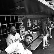 Jose Bautista and Edwin Encarnacion, (behind), Toronto Blue Jays, in the dugout preparing to bat during the New York Mets Vs Toronto Blue Jays MLB regular season baseball game at Citi Field, Queens, New York. USA. 15th June 2015. Photo Tim Clayton