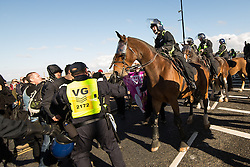 © Licensed to London News Pictures . 22/10/2016 . Margate , UK . Mounted police attempt to separate marchers and anti fascist protesters . A White Lives Matter protest and march , opposed by antifascists , is held in Margate , Kent . Photo credit : Joel Goodman/LNP