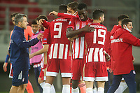 PIRAEUS, GREECE - OCTOBER 21: Players of Olympiacos FC celebrate after the UEFA Champions League Group C stage match between Olympiacos FC and Olympique de Marseille at Karaiskakis Stadium on October 21, 2020 in Piraeus, Greece. (Photo by MB Media)