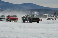 The RWD 4 Cyl Class racing Sunday afternoon on Meredith Bay during the Nostalgic Latchkey Cup with Lakes Region Car Racing.  (Karen Bobotas/for the Laconia Daily Sun)