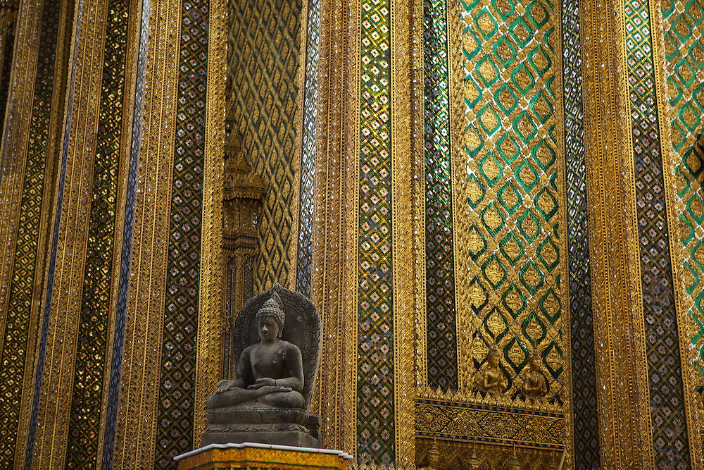 Phra Mondop, at Wat Phra Kaeo (Temple of the Emerald Buddha) inside the grounds of the Grand Palace, Bangkok. This building--guarded by five-headed Nagas (snakes) with human faces at the doors, and replicas of early ninth-century Dhyani Buddhas from Candi Plaosan in central Java at the corners--houses the repository for the Pali Canons. The exterior walls are green mirrored tiles inlaid with gold medallions depicting the Buddha.