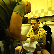 """Jonathan Oquendo gets ready in the dressing room during the """"Boxeo Telemundo"""" boxing match at the Kissimmee Civic Center on Friday, March 14, 2014 in Kissimmme, Florida. (Photo/Alex Menendez)"""