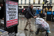 As the Coronovirus pandemic takes hold across the UK, with health authorities reporting cases rising from 25 to 87 in a single day, and resulting in the UKs chief medical officer Prof Chris Whitty announcing that an epidemic in the UK was highly likely, Londoners pass-by Evening Standard headlines at Charing Cross in central London, on 4th March 2020, in London, England.