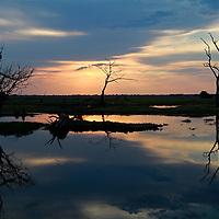 Africa, Botswana, Savute. Sunset Reflections at Savute in Chobe National Park.