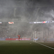 Goalkeeper Eric Kronberg, Sporting Kansas City surrounded by smoke from flares during his sides 2-1 loss during the New York Red Bulls V Sporting Kansas City, Major League Soccer Play Off Match at Red Bull Arena, Harrison, New Jersey. USA. 30th October 2014. Photo Tim Clayton