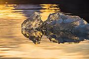 Lump of ice, backlit by the sun, floating in Kongsfjord, Spitsbergen | Isklump opplyst av solen, flytende i Kongsfjord på Svalbard