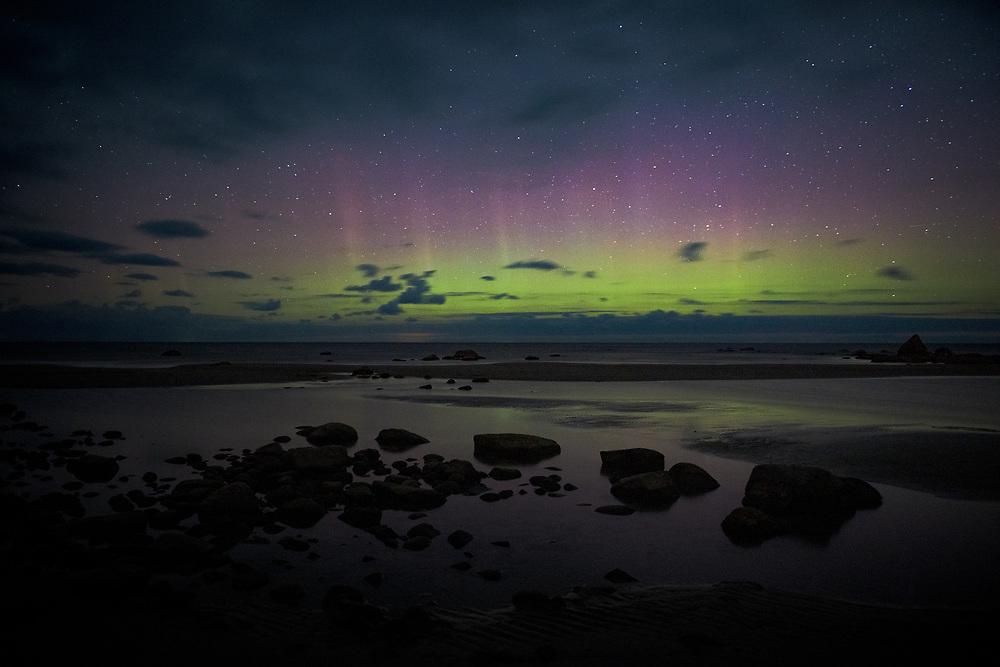 Night sky with Aurora borealis over rocky seashore, Mērsrags, Kurzeme Seacoast, Latvia, Ⓒ Davis Ulands | davisulands.com