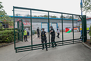 """Leicester, United Kingdom, May 19, 2021: Police enforcement arrived at the Elbit System's manufacturer s people gathered to support UK based Pro-Palestinian activists group """"Palestine Action"""" who seized control of the Leicester based factory of Elbit subsidiary UAV Tactical Systems on Wednesday, May 19, 2021. Activists say that """"the occupation is aiming to be as disruptive as possible; these activists are determined to prevent Elbit from resuming its business of bloodshed."""" (Photo by Vudi Xhymshiti/VXP)"""