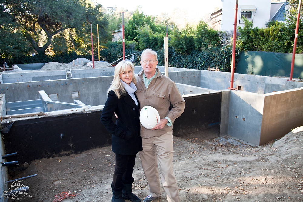 """Ed begley Jr. and Rachelle Carson-Begley. Steel framing began on 1/14/2013 over the foundation on the Begley's new home. Steel, while not a common material for residential framing, is 94% recyclable, has been milled locally for this project, and is a more sustainable choice than wood, which is typically used for residential building construction. Ed Begley Jr. (noted actor and environmentalist) and his wife Rachelle Carson-Begley are building their new home under LEED Platinum Certified standards in an attempt to become North America's greenest, most sustainable home. It is also being filmed for their web series """"On Begley Street."""" Studio City, California, USA"""