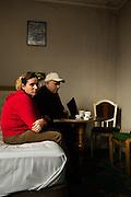 """Ekren (42jr.) agrarier en zijn vrouw Elmie Aliu uit Kosovo bivakeren sinds hun aankomst in Brussel in een door Fedasil betaalde hotelkamer. Het is er krap en bedompt maar dit hotel in een mooie buitenwijk van Brussel (Sint Pieters Woluwe) is beter dan menig andere asielzoeker. """"We krijgen elke dag twee checques van 6 euro, waarmee we eten etc. kunnen kopen. Jammer dat we geen buskaartjes kunnen aanschaffen, want 7 maanden in en rond dit hotel  is wel lang.  photographer in Brussels"""