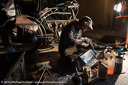 Jon Szalay of NJ completely rebuilds the gas tank on his 1913 Thor in the parking lot of the hotel at the end of the day during the Motorcycle Cannonball Race of the Century. Stage-13 ride from Williams, AZ to Lake Havasu City, AZ. USA. Friday September 23, 2016. Photography ©2016 Michael Lichter.