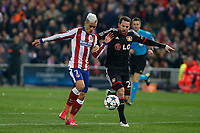 Atletico de Madrid´s Griezmann (L) and Bayer 04 Leverkusen´s Castro during the UEFA Champions League round of 16 second leg match between Atletico de Madrid and Bayer 04 Leverkusen at Vicente Calderon stadium in Madrid, Spain. March 17, 2015. (ALTERPHOTOS/Victor Blanco)