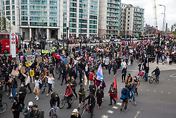 London, UK. 1st May, 2021. Thousands of people attending a Kill The Bill demonstration pass through Vauxhall as part of a National Day of Action to mark International Workers Day. Nationwide protests have been organised against the Police, Crime, Sentencing and Courts Bill 2021, which would grant the police a range of new discretionary powers to shut down protests.
