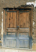 Varnish weathers and fades on an old door in Huaraz, Peru, South America.