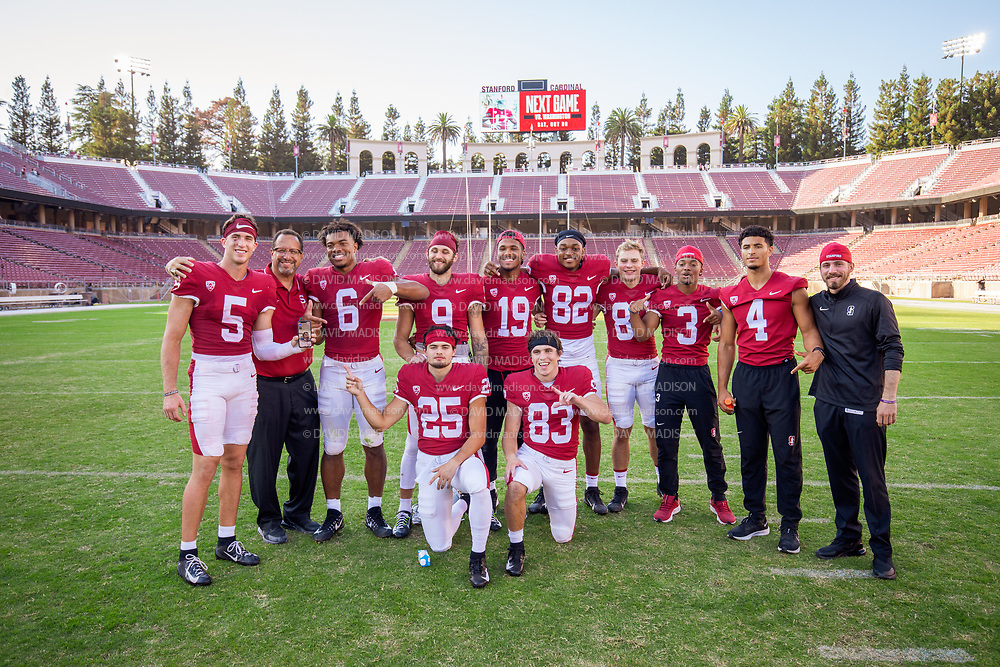 PALO ALTO, CA - OCTOBER 2:  Stanford Cardinal wide receivers pose on the field after Stanford's 31-24 overtime victory over the Oregon Ducks in a Pac-12 college football game on October 2, 2021 at Stanford Stadium in Palo Alto, California; (L-R) John Humphreys #5, Wide Receivers Coach Bobby Kennedy, Elijah Higgins #6, Colby Bowman #9, Silas Starr #19, Jayson Raines #82, David Kasemervisz #80, Marcus Graham #3, Michael Wilson #4, Graduate Assistant Thomas Merkle, Bryce Farrell #25, Danny McFadden #83. .  (Photo by David Madison/Getty Images)