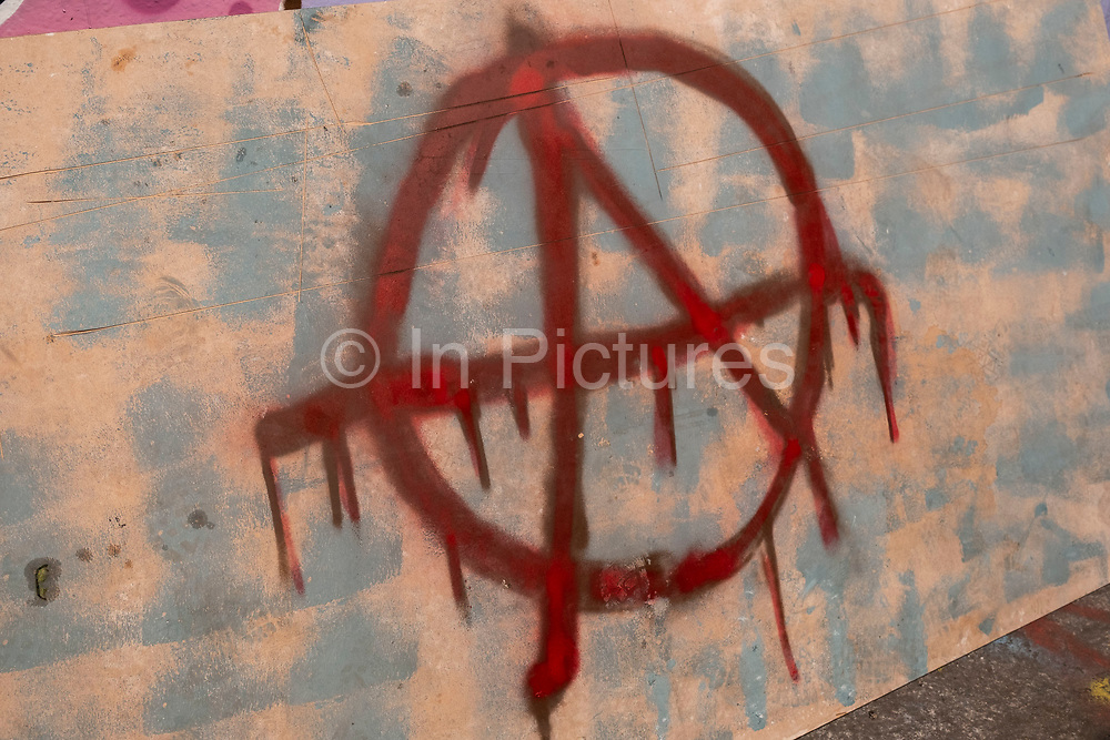 Anarchy symbol graffiti on 13th April 2021 in London, United Kingdom. The circle-A anarchist symbol is a monogram that consists of the capital letter A surrounded by the capital letter O. The letter A is derived from the first letter of anarchy or anarchism in most European languages.