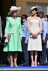 The Duchess of Cornwall (left) the Duchess of Sussex at a garden party at Buckingham Palace in London which she is attending as her first royal engagement after being married.