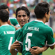 Aldo De Nigris, Mexico, (centre) celebrates after scoring with team mate Jesus Molina during the Mexico V Wales international football friendly match at MetLife Stadium, East Rutherford, New Jersey, 23rd May 2012. Photo Tim Clayton
