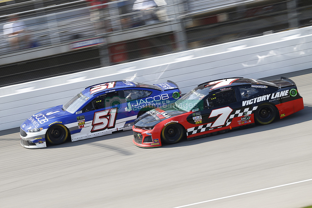 August 12, 2018 - Brooklyn, Michigan, United States of America - BJ McLeod (51) and Garrett Smithley (7) battle for position during the Consumers Energy 400 at Michigan International Speedway in Brooklyn, Michigan. (Credit Image: © Chris Owens Asp Inc/ASP via ZUMA Wire)