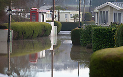 © Licensed to London News Pictures 28/12/2020. Yalding, UK. Little Venice Caravan parks main driveway is flooded. Yalding village in Kent and surrounding areas are flooded due to the river Medway and river Beult bursting their banks. Photo credit:Grant Falvey/LNP