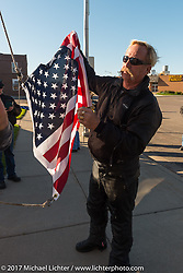 Flying the flag during a stop in Groton, SD for a flag raising ceremony during the USS South Dakota submarine flag relay across South Dakota. USA. Sunday October 8, 2017. Photography ©2017 Michael Lichter.