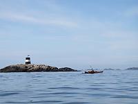 Calm weather - approaching Lindesnes - kajakkpadler nærmer seg Lindesnes