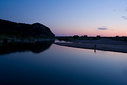 Stock photo of dusk along the still waters of the Llano River in the Texas Hill Country