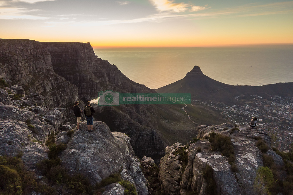 April 20, 2018 - Cape Town, Western Cape, South Africa - CAPE TOWN, SOUTH AFRICA - APRIL 2018: Aerial view of tourists on Table Mountain at sunset, South Africa. (Credit Image: © Amazing Aerial via ZUMA Wire)
